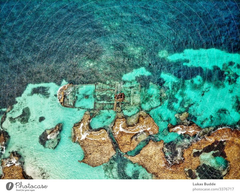 Drone photo of a shipwreck in the sea between rocks on Rottnest Island in Australia Wreck Ocean drone photo Aerial photograph Rock Coral reef Drone pictures