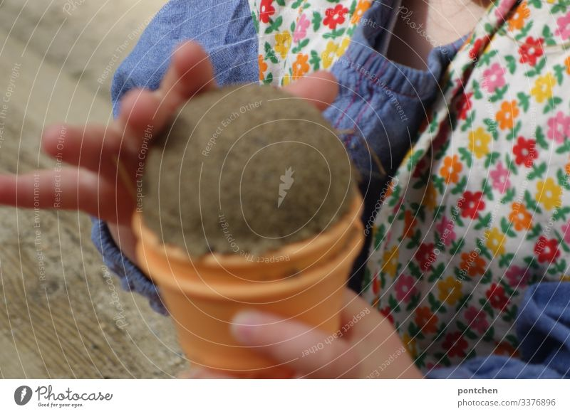 Children's hands form a ball of ice from sand Toddler Sand Playing Joy shape Sandpit Playground Pattern Ice Ice-cream cone sand mold Summer Colour photo