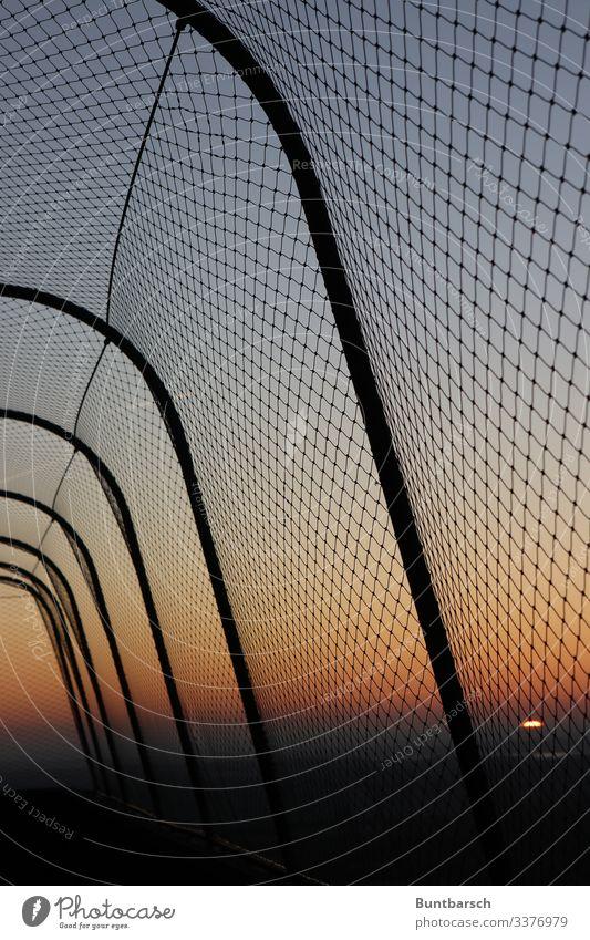 Safety fence in the evening light Fence protective fence Border Wire netting Wire netting fence sunset Sunset Orange Metalware Barrier Deserted Exterior shot