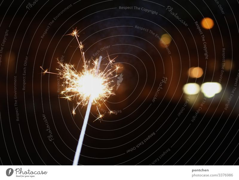 Sparklers and points of light illuminate the dark room. burn Burn star projector celebrations Party Christmas New Year's Eve light points Flash photo