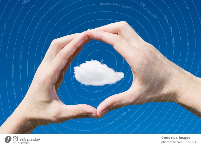 Man framing a cloud in his hands Clouds Idea Creativity Focus Human hand Personal perspective Scale Scrutiny point of view freedom gesturing concept ideas blue