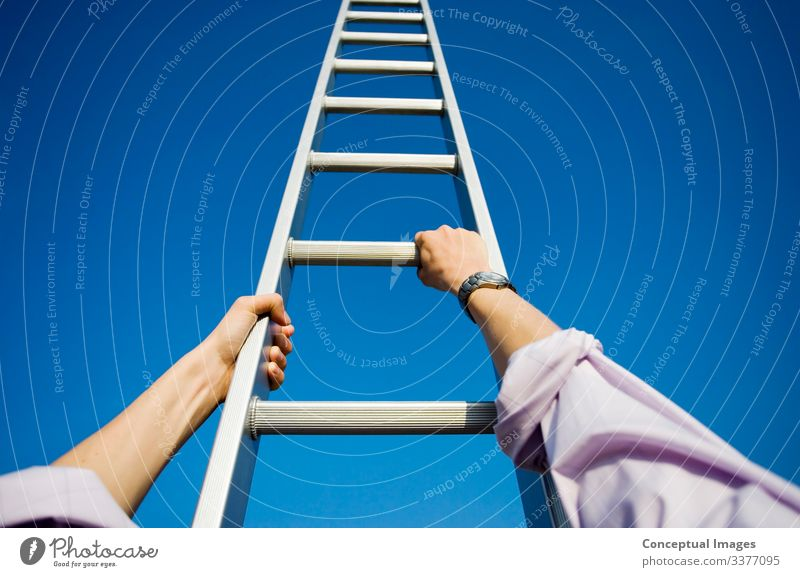 Businessman climbing a ladder Success Hope Idea Aspirations Balance High section Ladder Ladder of success Looking up Opportunity Motivation Moving up