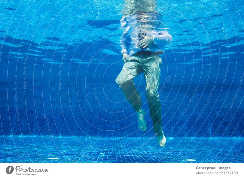 Low angle of businessman underwater Man Adults Legs 1 Human being Turquoise Businessman Head above water Low angle view Midsection Out of context Struggle