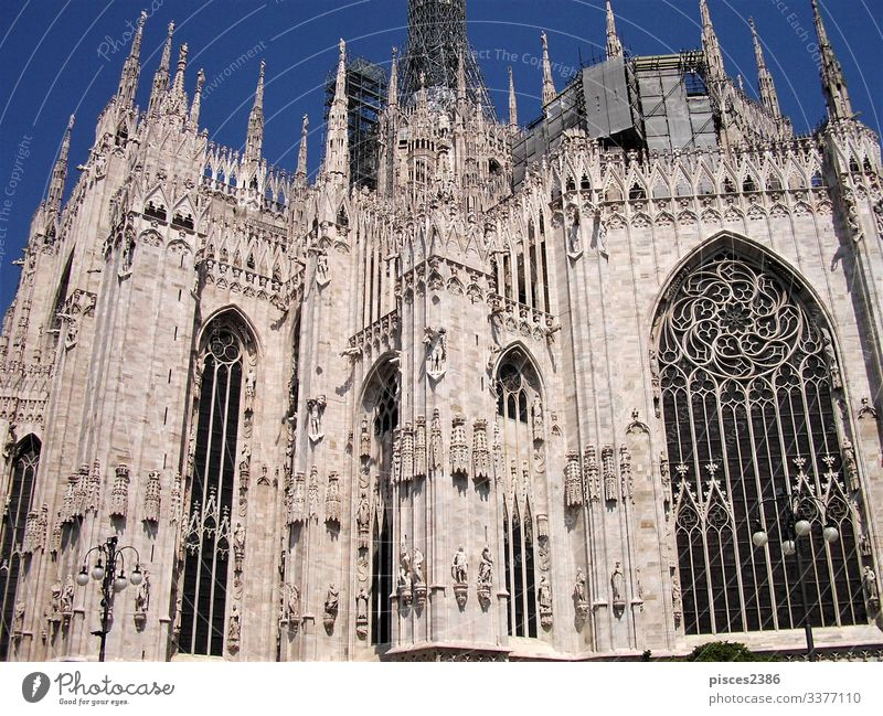 Windows and white marble architecture of the cathedral in Milan Skyline Dome Facade Air Traffic Control Tower Religion and faith Kite history landmark Italy