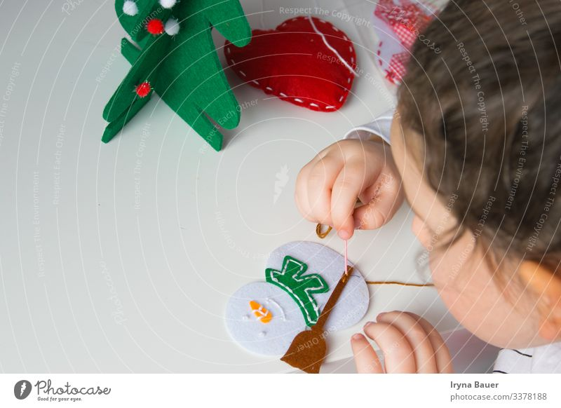 Child make snowmans for christmas. Lifestyle Design Joy Leisure and hobbies Playing Handicraft Model-making Living or residing Flat (apartment) Room