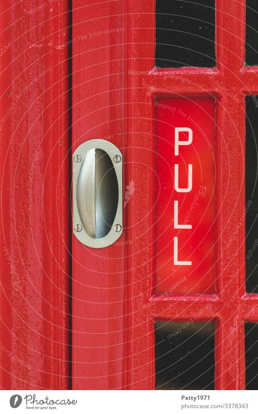 "Door handle and ""Pull"" lettering on an English telephone box Telephone Phone box England Characters pull Red Nostalgia Tourism Undo Colour photo Close-up Detail"