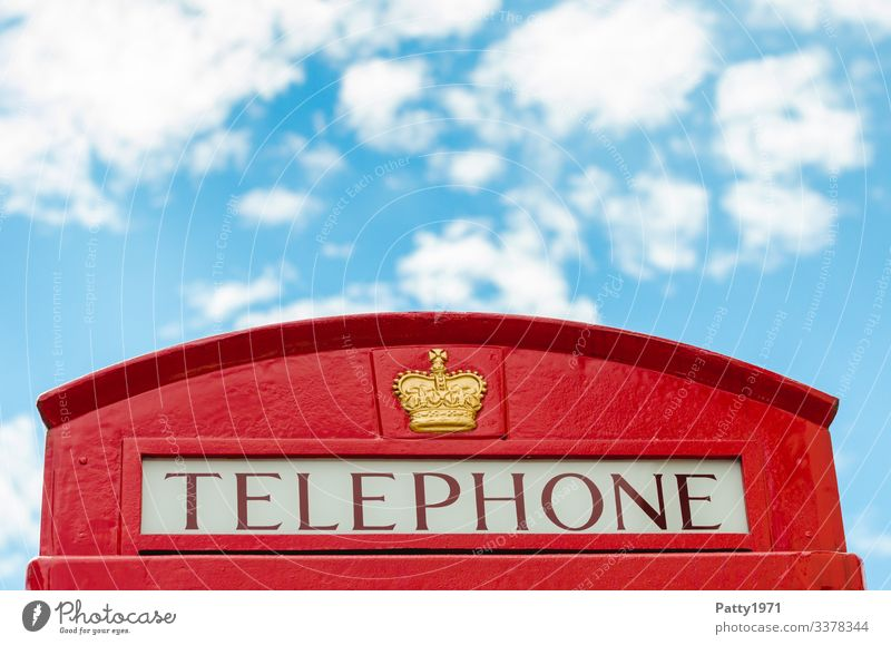 English phone booth and a piece of heaven Telephone Phone box Sky England Bright Blue Red Communicate Nostalgia Tourism Colour photo Exterior shot Detail