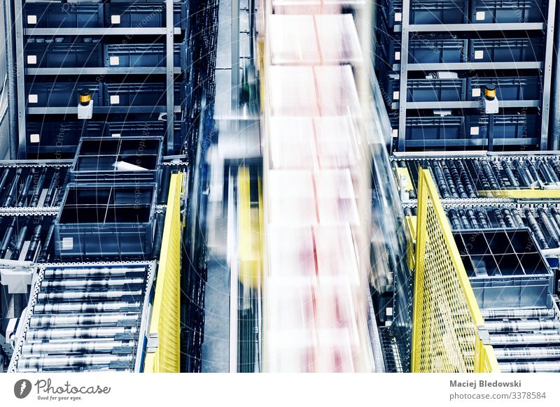 Moving lift in an automated warehouse. factory logistics distribution center conveyor management system roller production box manufacturing industry plant