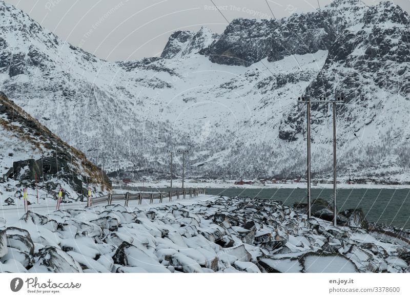 Winter landscape on the Lofoten Islands Vacation & Travel Snow Environment Nature Landscape Ice Frost Rock Coast Ocean Traffic infrastructure Street Cold