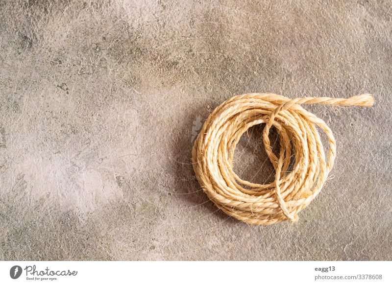 View of a roll of rope on a golden background Decoration Tool Curl Sphere Old Simple Idea backdrop Biodegradable Bobbin border braided cable cabling coil