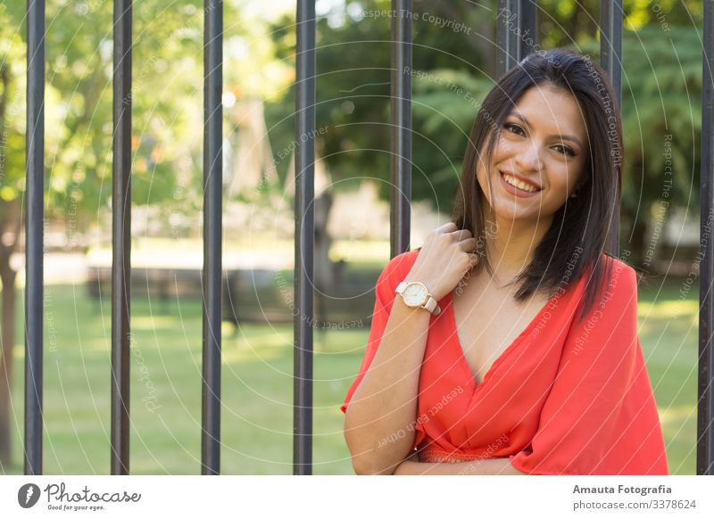 Woman smiling at camara againt the fense Human being Feminine Young woman Youth (Young adults) Adults Body 1 18 - 30 years Emotions Moody Joy Happy Happiness