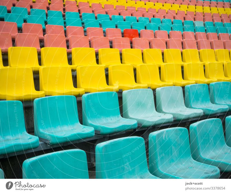 Rows of seats in different colours, but an exception proves the rule Seat series Station colourful Structures and shapes Design Block background Long shot