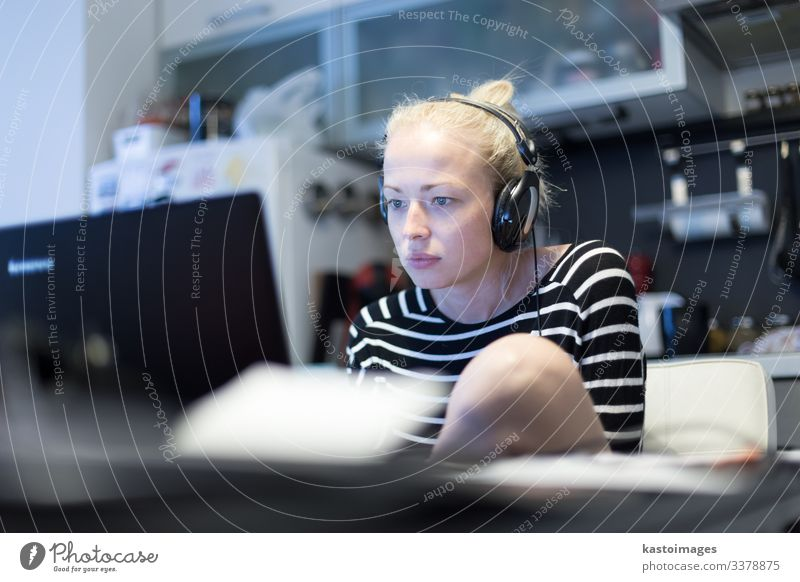 Woman working and studying remotely at night. Lifestyle Calm Reading Far-off places Table Kitchen Work and employment Workplace Office Business Computer