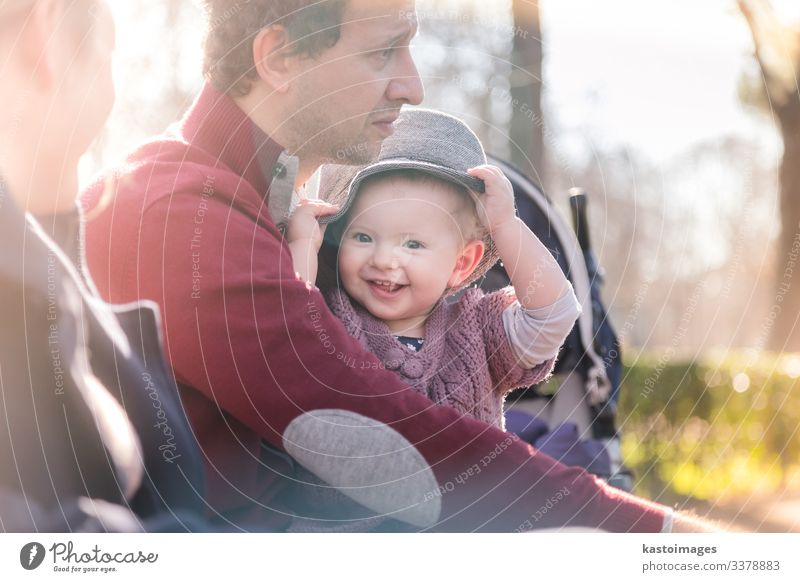 Young happy family with cheerful child having fun in park on sunny day. Lifestyle Joy Happy Beautiful Leisure and hobbies Playing Child Toddler Woman Adults Man