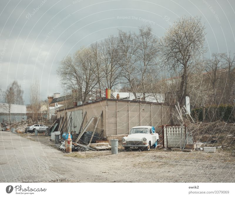 Used cars Scrapyard Clouds Tree Bushes greiz Thuringia Germany Outskirts Hut Building Shed Garage Car Odds and ends Things Trash container Old Trashy Gloomy