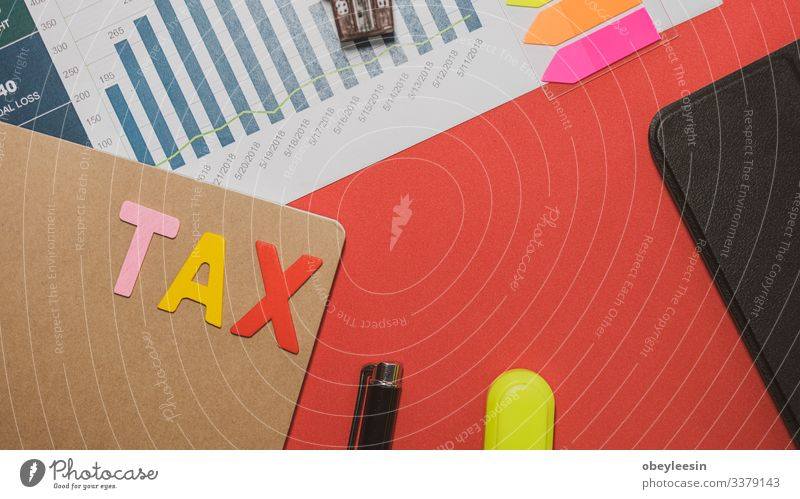 Tax Concept with wooden block on stacked coins Lifestyle Money Desk Table Success Work and employment Profession Office work Workplace Economy
