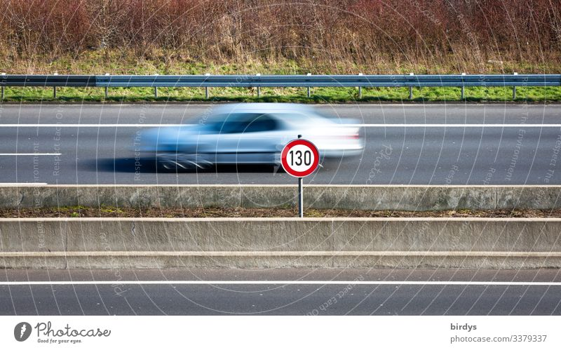 Speed limit 130, speed limit on German motorways. Sign at a motorway with passing car with motion blur. Climate change Transport Motoring Highway Road sign Car