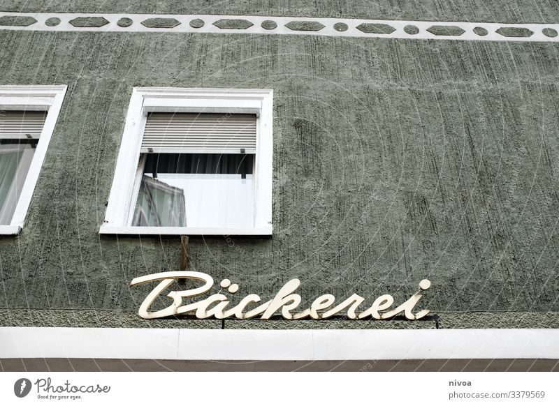 Facade of a bakery Bakery House (Residential Structure) Window pane Landscape format Paintwork Colour Lettering writing Signs and labeling Allgäu Roll Eating