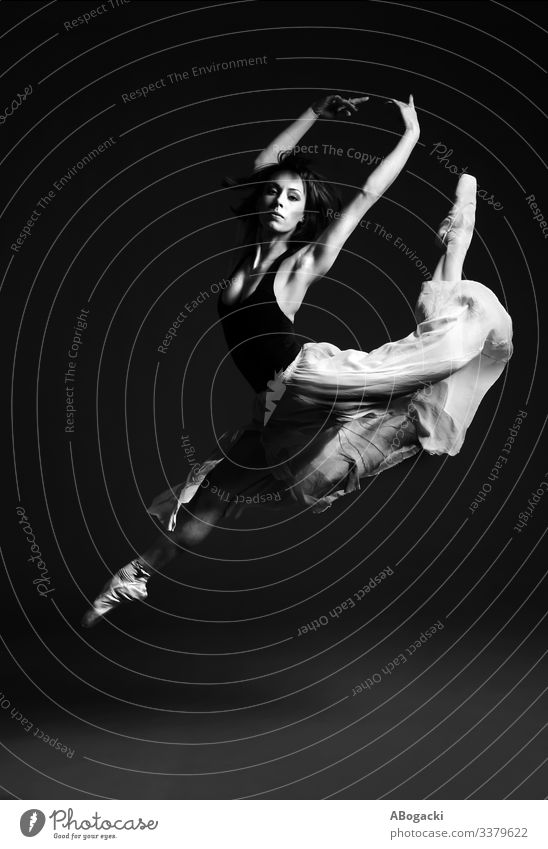 Ballerina in stag split leap, female ballet dancer in striking flying pose ballerina jump bw woman beautiful vintage retro clothes skirt dancing vitality