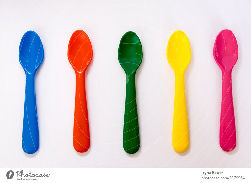 Lifestyle Design Decoration Kitchen Baby Blue Multicoloured Yellow Green Pink Red Appetite color spoon white nobody food Living thing child cooking empty object
