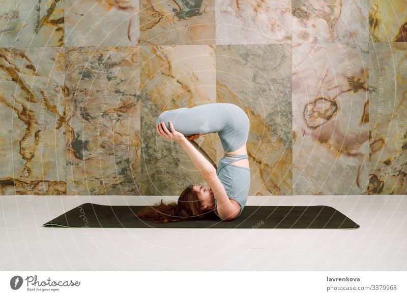 Yogini practising Urdhva padmasana pose, selective focus mindfulness active athletic body brunette calm caucasian exercise female flexible girl leisure