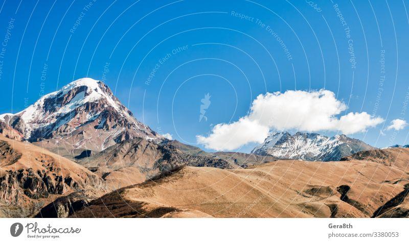 Vacation & Travel Tourism Trip Snow Mountain Wallpaper Nature Landscape Plant Sky Clouds Autumn Grass Hill Rock Stone Cold Brown Yellow White Caucasus Georgia