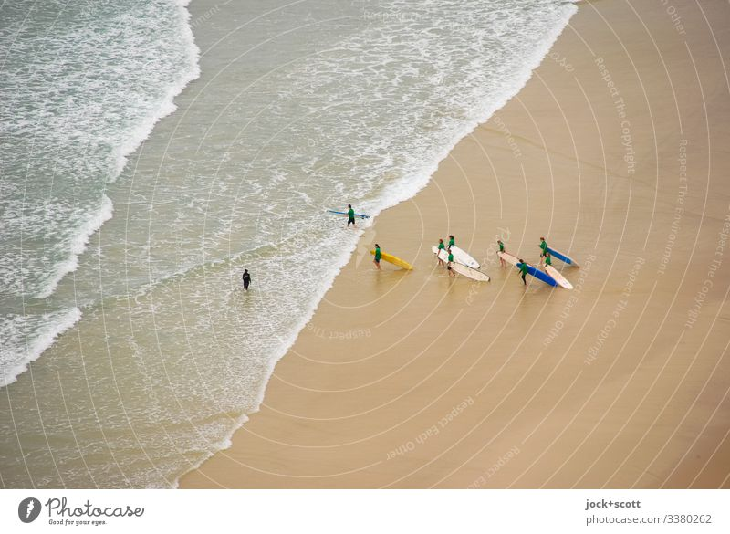 Surfers run together against the surf into the sea Pacific Ocean Waves coast Vacation & Travel Bird's-eye view Sunlight Beach life Society Freedom Experience