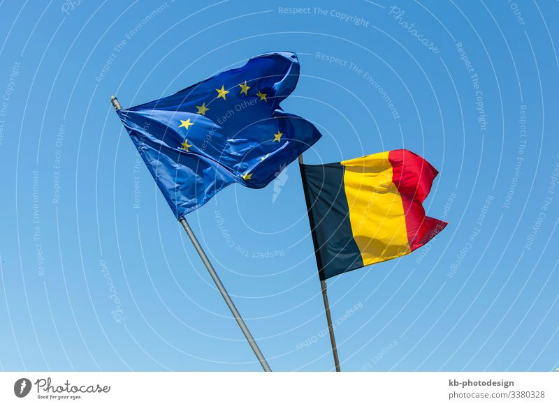 European flag with Belgium flag flags Belgian European parliament houses of parliament EU blue sky politics economics Sign signs symbol symbols