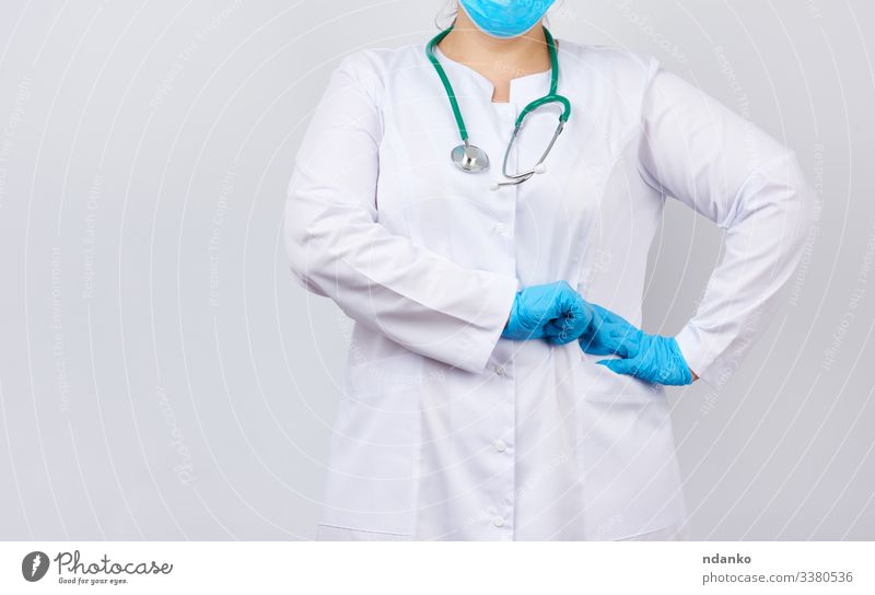 Health care Medication Profession Doctor Hospital Human being Woman Adults Arm Hand Coat Gloves Stand Friendliness Blue White Caucasian clinic Conceptual design