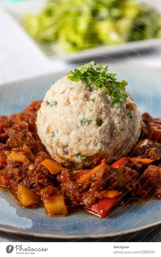 Meat Vegetable Bread Soup Stew Herbs and spices Dinner Bowl Spoon Table Hot Delicious Brown Red Goulash Dumpling Lettuce Vine Glass Parsley Austria Tomato sauce