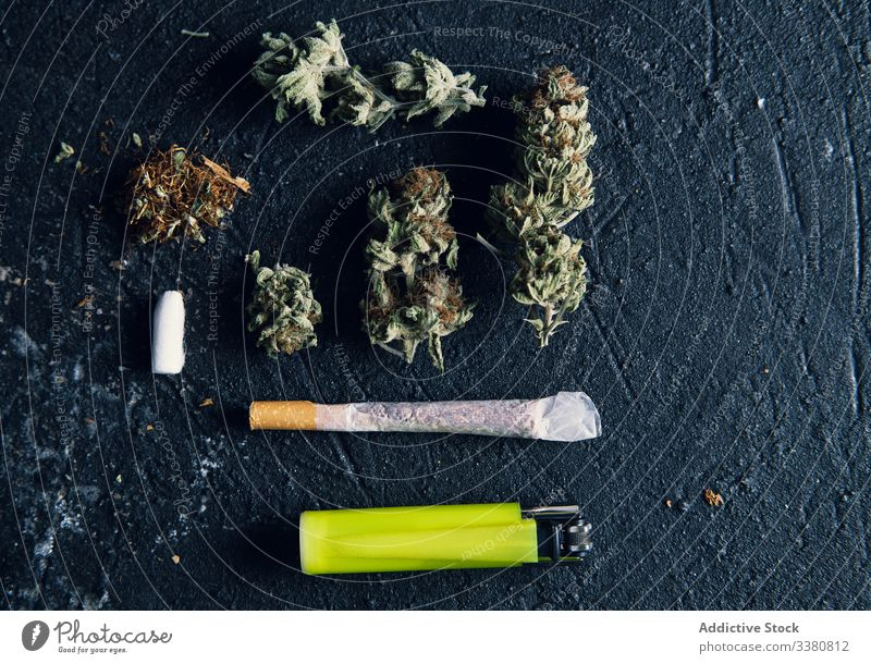 Marijuana buds and cigarette for making joint marijuana rolling paper grunge drug cannabis tobacco weed smoke herbal bad ganja dried medical high relaxation
