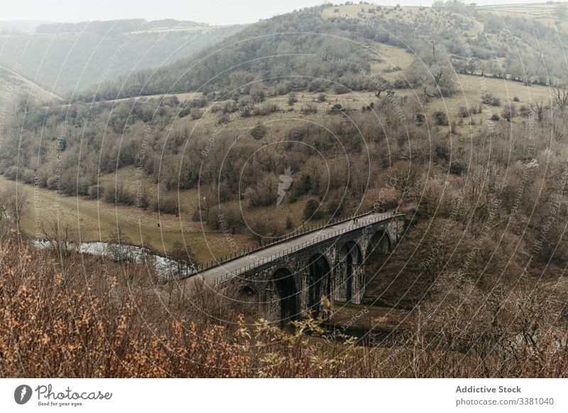 Old ancient bridge above small river in mountain valley hill structure travel nature transport architecture scenic tourism building construction destination old