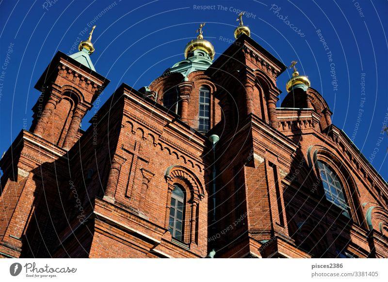 Details of the Uspenski Cathedral in Helsiniki architecture finland cathedral orthodox landmark europe sky eastern religion helsinki russian old brick cross