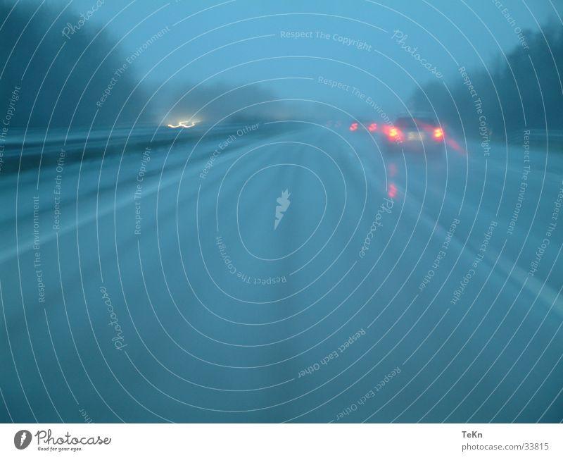 German motorway Wet Highway Speed Gloomy Fog Rear light Transport Rain Street Car