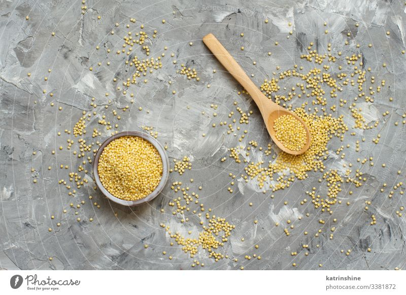 Vegetarian diet Diet Bowl Spoon Natural Above Yellow Gray Raw Millet hulled Dried fiber food healthy Ingredients Copy Space negative space nutritious Organic