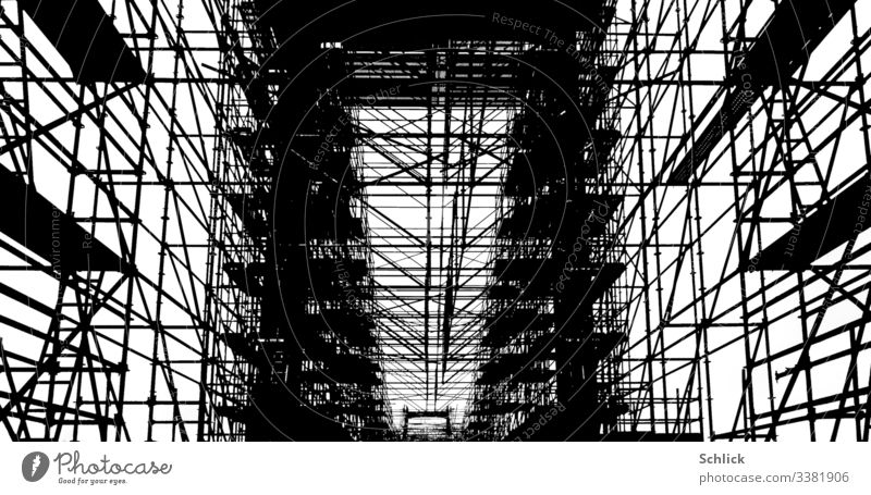 Photograph scaffolding at a bridge in black and white Scaffold Bridge photo graphic Black & white photo sharp contrasts high contrast Skeleton graphically Graph