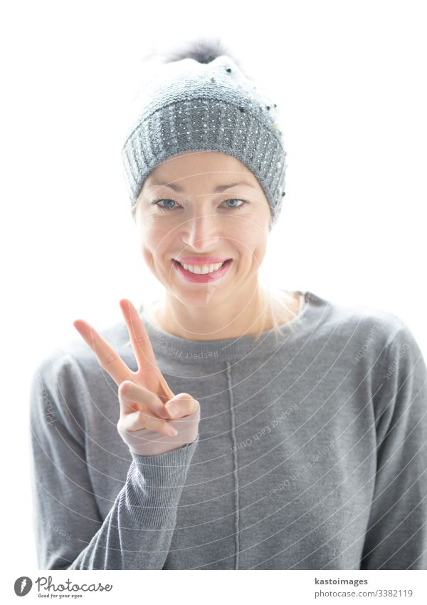 Close up portrait of cheerful caucasian woman, gesturing peace sign and smiles girl beautiful female happy hat white hand casual fun gesture playful joy student