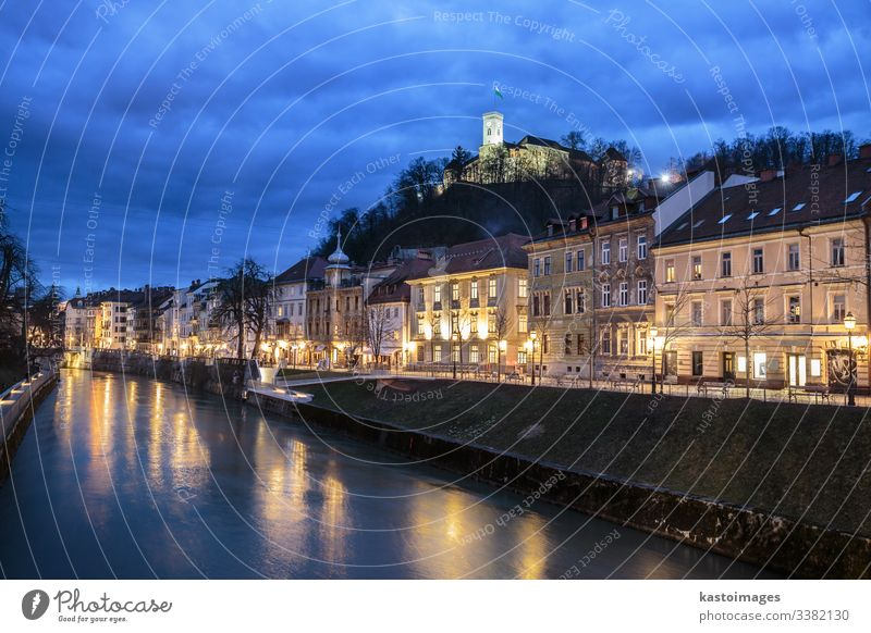 Evening panorama of riverfront of Ljubljana, Slovenia. ljubljana slovenia architecture blue bridge capital castle center city dark dusk europe european evening
