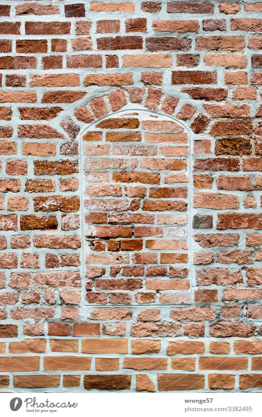 Brick wall with bricked up window opening Wall (barrier) brickwork walled up Wall (building) Exterior shot Colour photo Deserted Facade