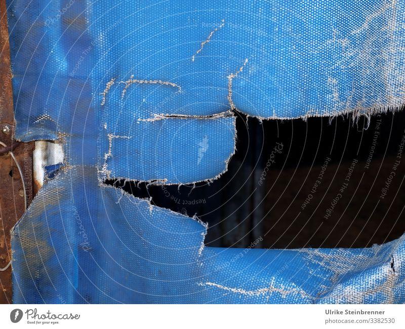Crack in blue truck tarpaulin Blue Crack & Rip & Tear torn Broken Transport freight traffic Freight transport Covers (Construction) Hollow Blache textile