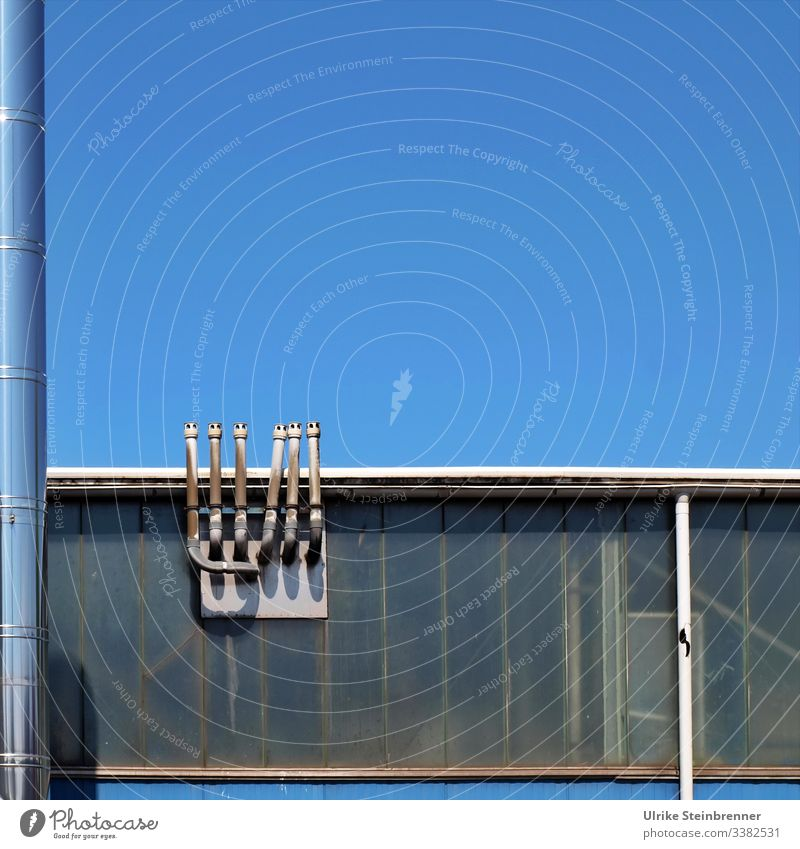 Industrial chimneys at warehouse in front of a blue sky Industry built Chimney Metal Sky Fireside Warehouse Hall Industrial plant High-grade steel Harbour