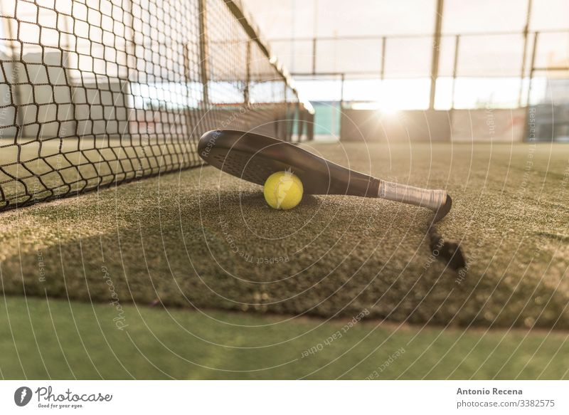 Paddle tennis image of court, racket, net and ball padel paddle tennis sport paddle-tennis pádel sunset tennis ball outdoors objects no people nobody fences