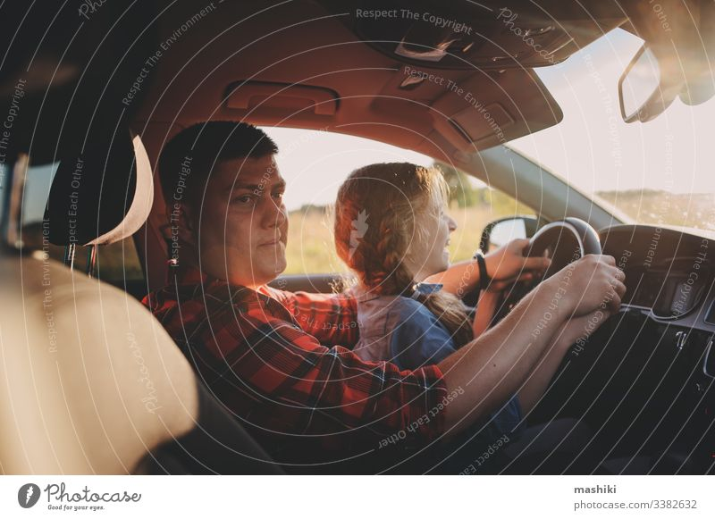 father teaching kid daughter to drive a car, family traveling on summer vacation child girl together happy trip vehicle parent journey lifestyle fun cheerful