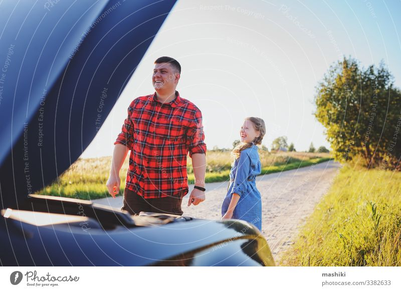 father and daughter fixing problems with car during summer road trip. Kid helping dad. child family girl mechanic repair automobile man outdoors vehicle parent