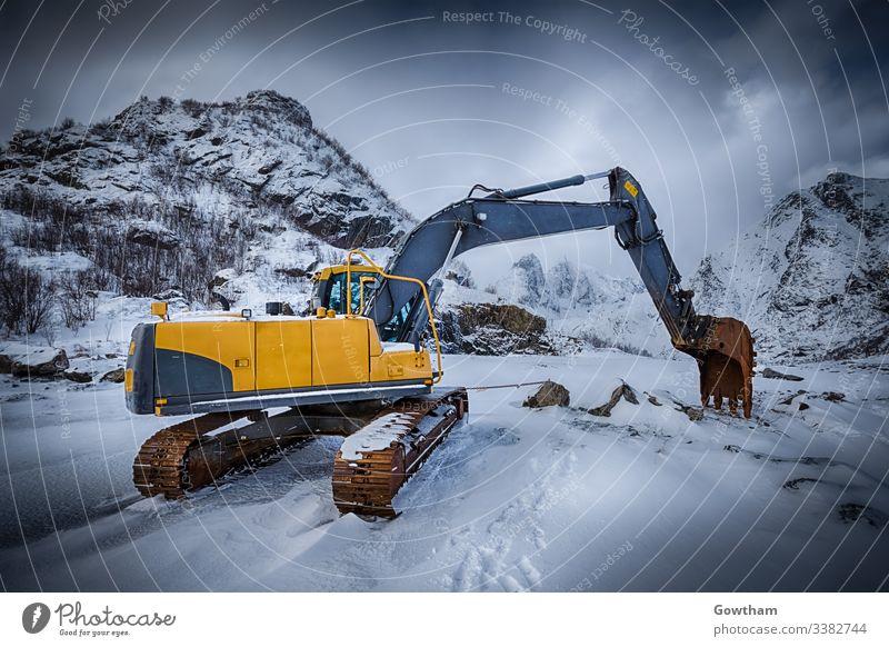 Old excavator in winter Norway norwegian Lofoten scenery Lofoten islands Lofoten archipelago scenic Nordland Scandinavia Scandinavian excavator cab grunge rusty
