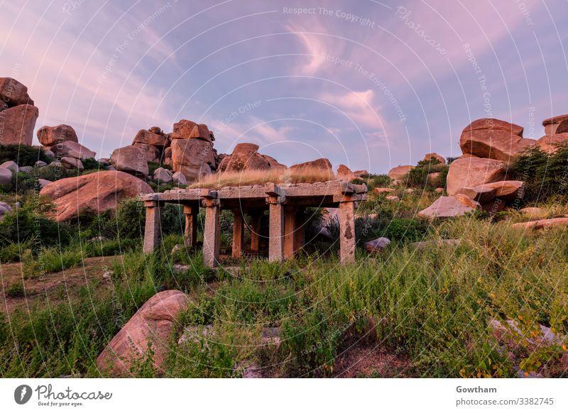 Ancient ruins of Hampi on sunset. India Hampi Bazaar Karnataka ancient architecture pillars pavilion HDR HDRI ancient civilization boulder boulders