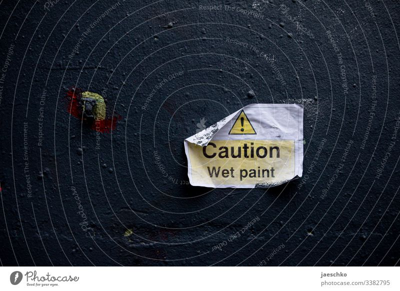 "Sign ""Caution - wet paint"" on a wall Colour freshly painted Painting (action, work) Damp Wall (building) Clue Signage Warn Warning sign painting works"