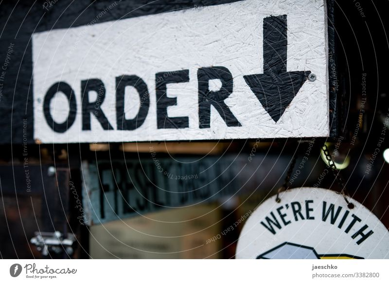 """""""Order"""" sign at street food stand order here Restaurant food serving counter Counter Expenditure Eating fast food Fast food restaurant London England Lunch"""