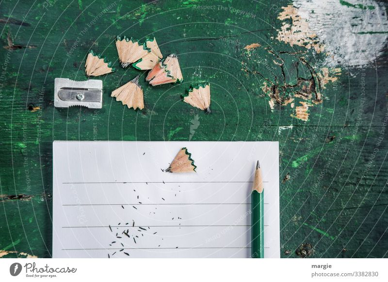 Chaos - Desk Arrangement Office Workplace pen Pencil sharpener Piece of paper lines Green Stationery Paper Interior shot Office work School disorder havoc Study