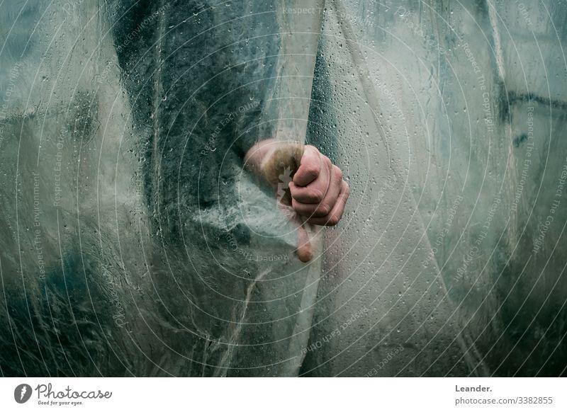 adherence stop Retentive Packing film Horror film horror trip Hand Green Men`s hand Rain Wet plastic